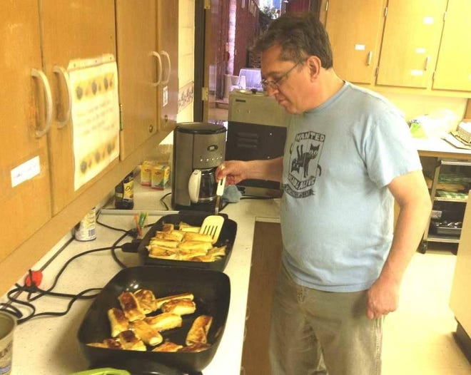 Temple Beth Sholom's Dan Katz prepared blintzes for the temple's 2016 Blintze Brunch. This year's Blintze Brunch will be a curbside event May 2, with orders being due by May 1.