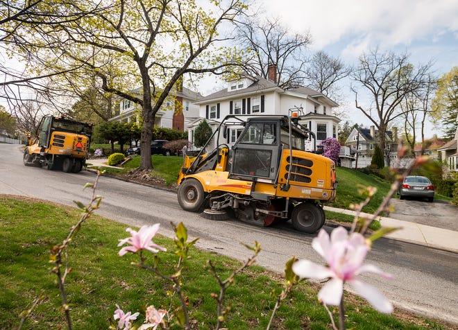 Street sweepers work on Chamberlain Parkway Wednesday.