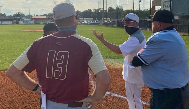 Coaches go over ground rules with the umpires before Tuesday's game in Alachua.
