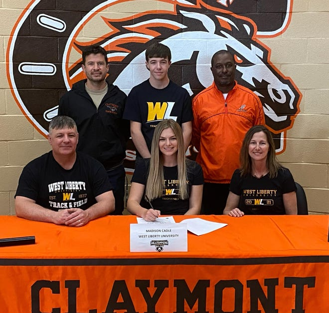 Claymont's Madison Cadle signed a scholarship to run track at West Liberty University Tuesday. She is with her parents Brian and Laura Cadle in the front row. In the back is Coach Adam Rogers, her brother Neil Cadle, and Coach Eric Peterson