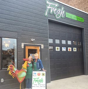 Denise Murray (left), manager of Fresh the Market, stands with her sister Debbie Aubihl-Knisely, the store'sproprietor, outside the indoor farmers' market. Fresh the Markey will hold its grand opening May 1 in the building formerly occupied by Big D's Tires at 150 First Drive SW in downtown New Philadelphia.