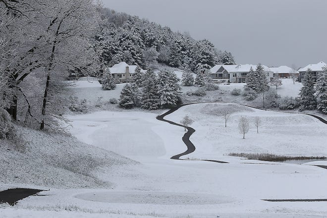 The fourth hole at Oak Shadows Golf Course was coated in snow Wednesday morning.