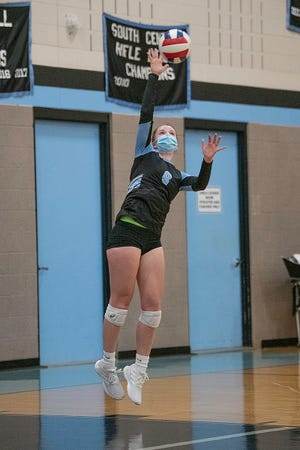 Pueblo West High School senior Paige Boitz serves the ball in the first set against South on Tuesday April 20, 2021.