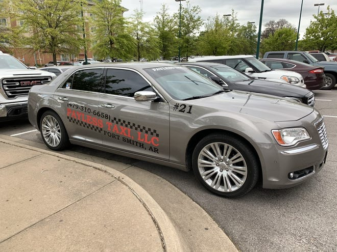 A Payless Taxi vehicle is seen outside the Fort Smith Convention Center Tuesday, April 20, 2021.