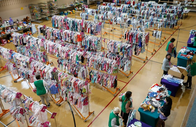 Volunteers work to set up the Spring Little Lambs Consignment Sale at the First United Methodist Church on Greensboro Ave. in Tuscaloosa, April 21, 2021. [Staff Photo/Gary Cosby Jr.]