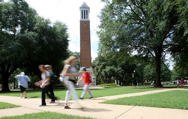 Students walk to and from classes in front of Denny Chimes on the Quad at the University of Alabama in Tuscaloosa, Ala. on Wednesday, Aug. 19, 2015. [Staff file photo]