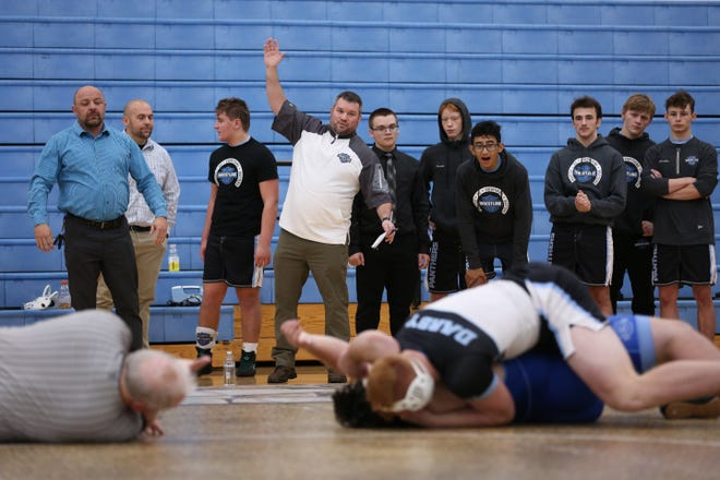Hilliard Darby wrestling coach Brendan Moody watches a match in December 2019. Moody told his team April 20 that he was stepping down after 12 seasons.