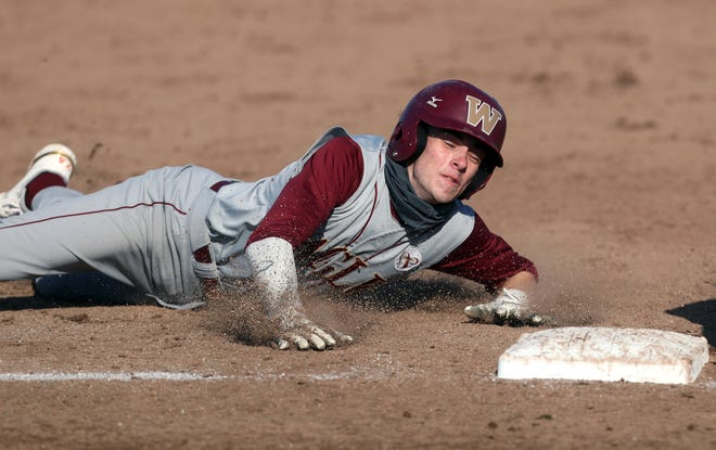 """Watterson's Max McCann slides safely into third base during a game against Olentangy Berlin on April 13. McCann, a senior, said he likes the way the Eagles have been battling opponents, proving they're """"ready to compete in big games."""""""