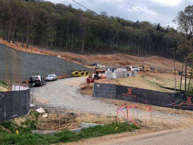 Two new apartment buildings, part of a development called Enclave, are under construction off Piney Mountain Road in the Chunns Cove area. The grading and site work is visible from I-240 in Asheville.