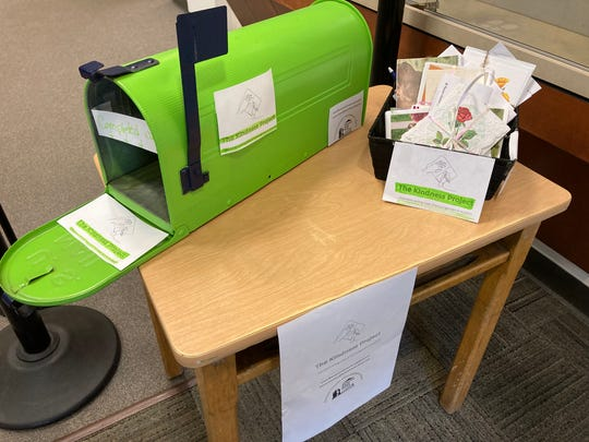 The Bremerton School District uses a green mailbox, where volunteers can place envelopes containing hand-written cards and letters for students and staff.