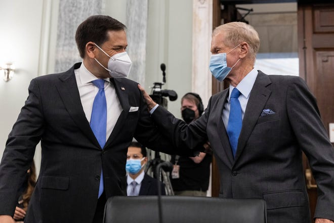 Former Sen. Bill Nelson, nominee to be administrator of NASA, greets Sen. Marco Rubio, R-Fla., prior to the start of a Senate Committee on Commerce, Science, and Transportation confirmation hearing, Wednesday, April 21, 2021 on Capitol Hill in Washington. (Graeme Jennings/Pool via AP)