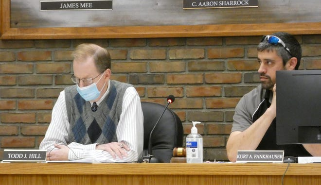 Bucyrus City Council Clerk Todd Hill and President Kurt Fankhauser listen to debate during a special committee meeting Tuesday. Hill later resigned.