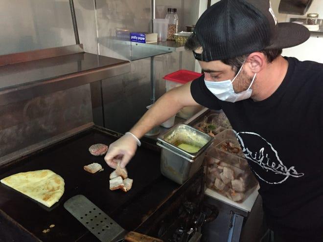 Drifter's owner Andrew Ryan cooks on the grill at the Burlington restaurant April 20, 2021.