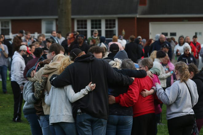Friends and family gathered to remember Brianna Ratliff, 20, of Coshocton, during a vigil at Hall Park on Tuesday.