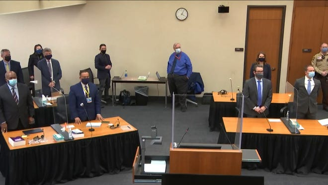In this image from video, defense attorney Eric Nelson, and defendant, former Minneapolis police Officer Derek Chauvin, both on the right side of the courtroom, arrive for the verdict in Chauvin's trial for the 2020 death of George Floyd on April 20, 2021, at the Hennepin County Courthouse in Minneapolis, Minn. Behind the front table at left is prosecutor Jerry Blackwell, left, and Minnesota Attorney General Keith Ellison. Behind the rear table at left is prosecutor Steve Schleicher, left, and Assistant Minnesota Attorney General Matthew Frank.