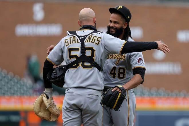 Richard Rodriguez of the Pittsburgh Pirates celebrates a 3-2 win over the Detroit Tigers with Jacob Stallings during game one of a double header at Comerica Park on April 21, 2021 in Detroit.