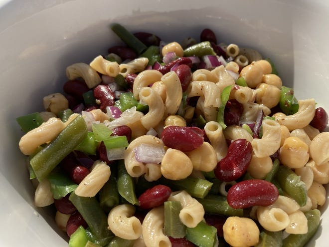 Three Bean Pasta Salad is loaded with vegetables.
