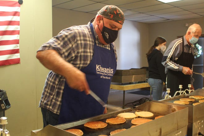 David Amarante, a Kiwanis Club of Fremont past president, flips pancakes Wednesday at the 61st Annual (Take-Two) Fremont Kiwanis Pancake Festival: DRIVE-THRU Edition. The event was held at Anjulina's Catering and Banquet Hall on Hayes Avenue.