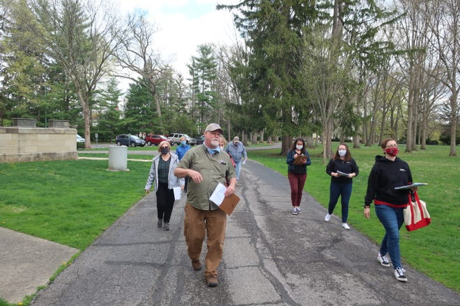 John Havens, Hayes Presidential Libraryand Museums board member and volunteer, developed the tree tour being offered on April 30 and  May 1. Here, Havens trains some of the tour guides for the upcoming tours.