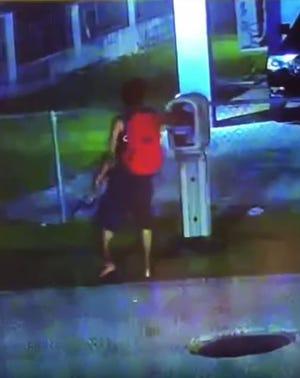 This surveillance video shows a mail theft suspect in Dededo.