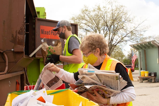 Recycle Livingston Site Manager Bonnie White sorts paper with a volunteer at Recycle Livingston, 170 Catrell St. in Howell on Saturday, April 17, 2021.