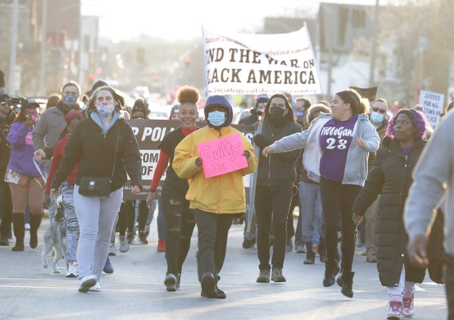 Protesters make their way down Center Street in Milwaukee  on Tuesday, April 20, 2021. The jury has found former police officer Derek Chauvin guilty on all counts in the murder of George Floyd last May.