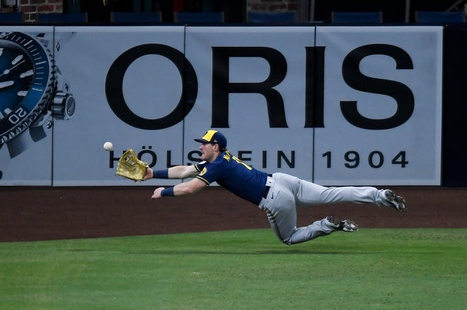 Billy McKinney  makes a diving catch on a ball hit by Wil Myers during the fourth inning that saves two runs.