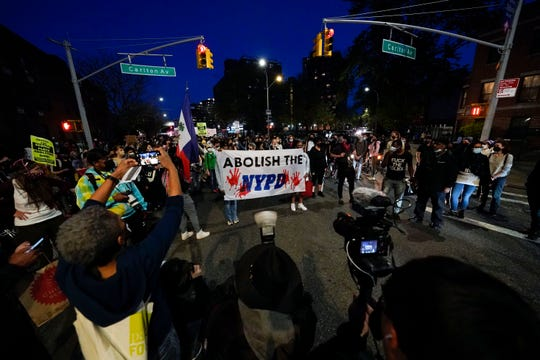 Hundreds march through Brooklyn, NY after former police officer Derek Chauvin is convicted in all three counts for the murder of George Floyd on Tuesday, April 20, 2021.