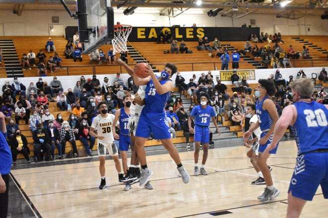 Tylen Gonzalez pulls down a defensive rebound Tuesday night during Carlsbad's 58-51 win over Hobbs in Tasker Arena. Gonzalez had four points, two rebounds, and a steal for the Cavemen.