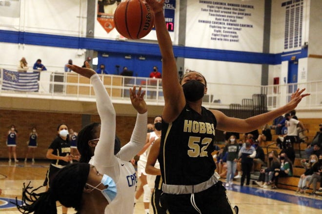 Hobbs freshman Aniya Joseph blocks a shot against the Carlsbad Cavegirls in their game on March 20, 2021. Carlsbad was scheduled to face Hobbs on Friday but had to cancel the game due to a Cavegirl testing positive for COVID-19 Friday morning.