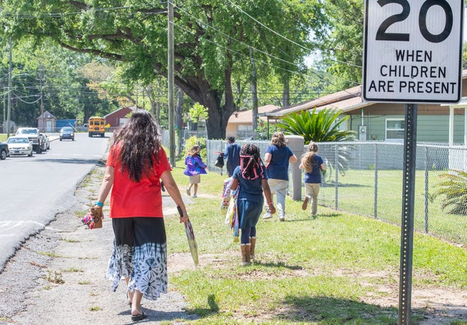 Students walk home from C.A. Weis Elementary School in Pensacola on Wednesday.