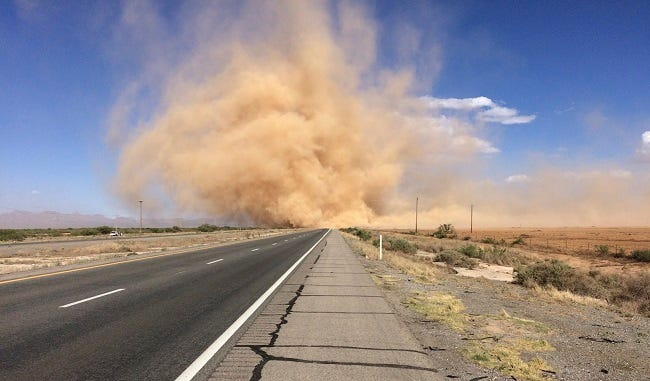 Dust blows on an Arizona highway, April 21, 2021, when a Red Flag Warning was issued for much of the state.