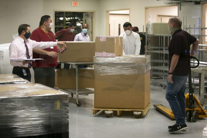Tabulation machines and related equipment used in the 2020 U.S. Presidential election in Arizona are boxed to be delivered to the Phoenix Veteran's Memorial Coliseum at the Maricopa County Elections Headquarters in Phoenix on April 12, 2021. The machines were being sent to the coliseum for an audit planned by the state senate.