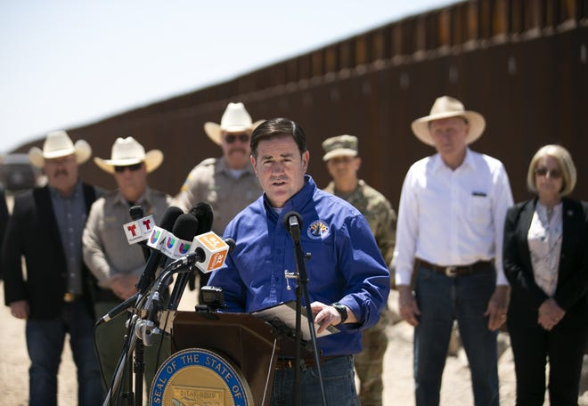 Arizona Gov. Doug Ducey speaks at the U.S.-Mexico border outside of Yuma on April 21, 2021. This week he penned a letter with Texas Gov. Greg Abbott asking other states to send law enforcement to help them police the border.