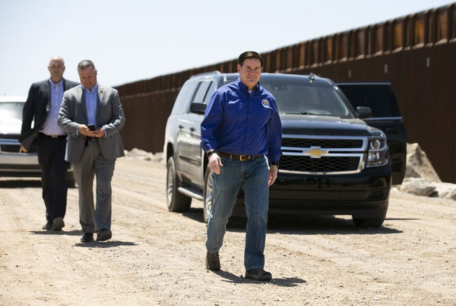 Arizona Governor Doug Ducey walks from his vehicle to speak to the media on the U.S. and Mexico border outside of Yuma on April 21, 2021. Ducey and other governors more recently sent a letter to President Biden criticizing his handling of the border.