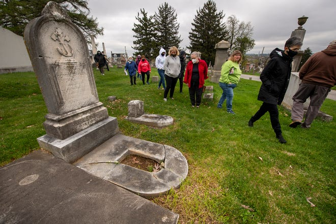 Members of the Garden Club of York plan how they will plant cradle graves at Prospect Hill Cemetery on April 14, 2021