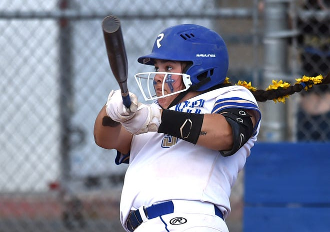 Reed's Alycia Coats' sits a home run during Tuesday softball game against Damonte Ranch at Reed High School on April 20, 2021. Reed won 19-4.