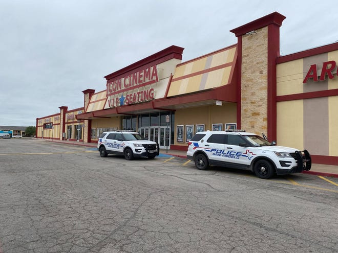 Police respond to an armed robbery at ICON Cinema, 2020 N. Bryant Boulevard on Wednesday, April 21, 2021.