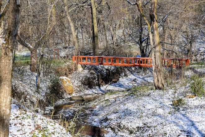 A small red bridge crosses over a creek bed at the Newton Hills Scout Camp on Wednesday, April 21, 2021, in Canton.
