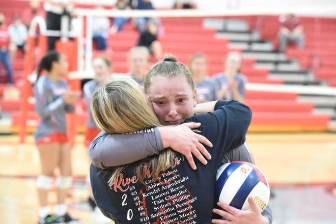 Riverheads' junior Dayton Moore hugs her mom after being honored for recording the 2,000 assist of her career. Riverheads beat Middlesex 3-1 to advance to the Class 1 state championship