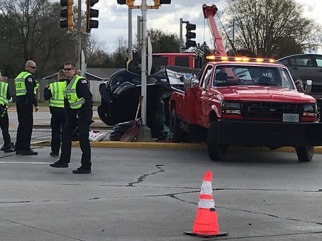 A Wisconsin Rapids squad hit while responding to another traffic crash was knocked onto its roof, according to a crash report released Wednesday. Everyone injured in the crash was released from the hospital.