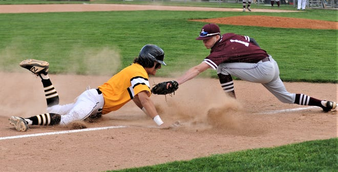 Tri-Valley's Ty Smith slides into third base before the tag by John Glenn third baseman Colin Campbell in Tuesday's game. The Scotties won 8-4.