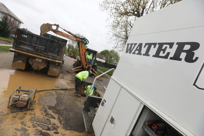 A crew from the Zanesville Water Department fixes a break recently. The city of Zanesville will embark on several projects to improve underground utilities this year.