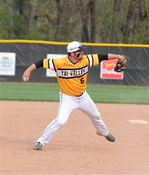Tri-Valley third baseman Aidan Fritter throws to first base in Tuesday's game with John Glenn. Fritter highlighted the area's East District baseball selections.