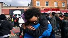 Nic Hernandez and Emma Ruddock hug in celebration after hearing the verdict of Derek Chauvin at George Floyd Square on April 20, 2021.