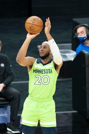 Timberwolves forward Josh Okogie shoots against the Sacramento Kings