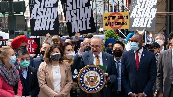 Senate Majority Leader Chuck Schumer, D-N.Y., center, is joined by U.S. Rep. Grace Meng, D-N.Y., third from left, at a news conference to discuss an Asian-American hate crime bill, Monday, April 19, 2021, in New York. Schumer is pushing for passage of the COVID-19 Hate Crimes Act in the Senate. (AP Photo/Mark Lennihan) ORG XMIT: NYML103