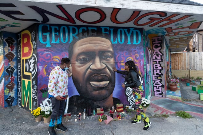 "Shantel Carson (right) and her son, Shavez Alston, pay their respects Tuesday, April 20, 2021 at a mural and memorial for George Floyd at the corner of N. Holton St.and E.North Ave. in Milwaukee, Wis. ""That could have been my son,"" said Carson. Former Minneapolis police officer Derek Chauvin was found guilty on all counts in the murder of Floyd last May."