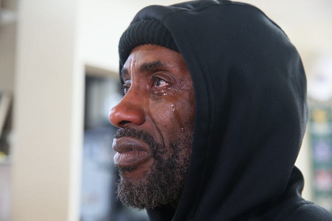 Adi Armour, 50, cries while watching  the verdict  being read on CNN on Tuesday, April 20, 2021 at Gees Clipper in Milwaukee. Derek Chauvin was found guilty of murder and manslaughter in George Floyd death ignited world wide protest.