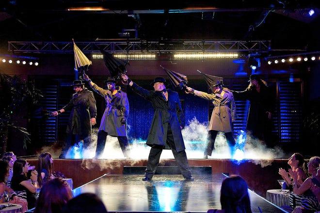 "Channing Tatum, center, stars in a scene of ""Magic Mike,"" the 2012 film."